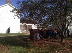 "Students hide behind a wood pile waiting to see if this house is a ""safe"" house"