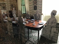 A fictional dinner gathering of early republic luminaries: Presidents Madison, Monroe, Jefferson and Jackson, the Marquis de Lafayette, Dolley Madison, and enslaved servant Paul Jennings (standing)