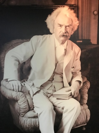 Mark Twain in his trademark white suit